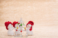 Snowman with fir tree. On illuminated background Stock Photo