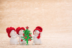Snowman with fir tree Stock Photo
