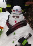 Snowman firefighter. Qianmen Dajie, Beijing, China Royalty Free Stock Image