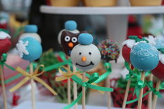 Snowman, fondant art. Christmas lollypop decorations with snowman in focus Royalty Free Stock Image