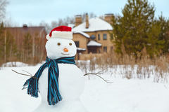 Snowman in a forest. Funny snowman in a forest. snowman in santa hat outdoors Royalty Free Stock Photos