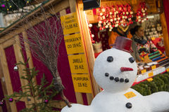 A snowman in fornt of the shops at the traditional Christmas markets at the Peace Square Namesti Miru in Prague, Czech republic Royalty Free Stock Images