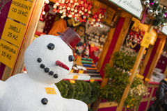 A snowman in fornt of the shops at the traditional Christmas markets at the Peace Square Namesti Miru in Prague, Czech republic Stock Image