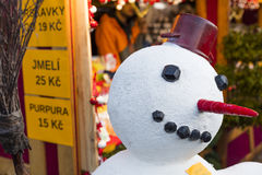 A snowman in fornt of the shops at the traditional Christmas markets at the Peace Square Namesti Miru in Prague, Czech republic Royalty Free Stock Image