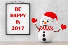 Snowman in front of Brick Wall with Frame Be Happy In 2017 Sign. Stock Photo