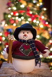 Snowman in Front of a Christmas Tree. This is a colorful snowman in front of a Christmas tree Royalty Free Stock Image