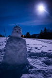 Snowman with a full moon Stock Photography