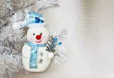 Snowman. Funny new year symbol of the New year snowman on a gray snowy background royalty free stock image