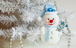 Snowman. Funny new year symbol of the New year snowman on a gray snowy background stock photos