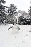 Snowman in a garden Stock Image