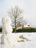 Snowman in garden half done Stock Photos