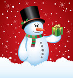 Snowman with a gift Stock Images