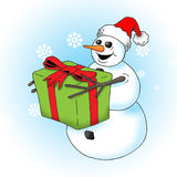 Snowman with Gift. Image of an excited snowman holding a big gift Royalty Free Stock Image