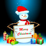 Snowman with Gift and Board Royalty Free Stock Images