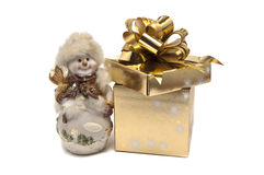 Snowman and gift box Royalty Free Stock Images