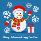 Snowman with gift box on Christmas Eve. Stock Photo