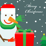 Snowman with a gift box Royalty Free Stock Photo
