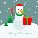 Snowman with a gift box Stock Image
