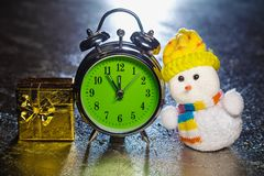 Snowman with gift box and retro alarm clock Stock Images