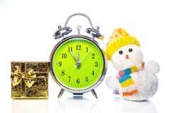 Snowman with gift box and retro alarm clock Royalty Free Stock Images