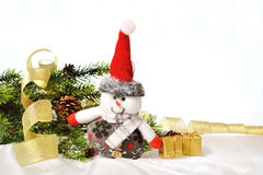 Snowman and gift box Royalty Free Stock Photo