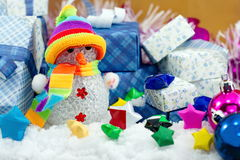 Snowman and gift box with small star paper Royalty Free Stock Image