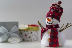 Snowman with gift boxes on the background stock photo