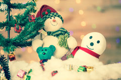 Snowman and gift boxes Royalty Free Stock Image