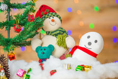 Snowman and gift boxes Royalty Free Stock Photography