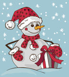 Snowman and gift Stock Image