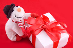 Snowman and giftbox Stock Photography