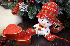 Snowman and gifts Stock Image