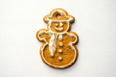 A snowman gingerbread cake isolated on white background royalty free stock photo