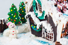snowman and gingerbread house Royalty Free Stock Photography