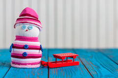 Snowman girl enjoying a sleigh ride. Handmade Royalty Free Stock Photo
