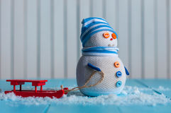 Snowman girl enjoying a sleigh ride. Handmade Stock Images