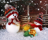 Snowman gives a Christmas gift to my friend Royalty Free Stock Photography