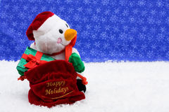 Snowman giving gifts Royalty Free Stock Photos