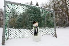 Snowman goalkeeper Stock Photo