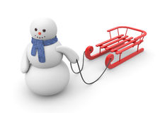 Snowman goes to ride on red sled Stock Photo