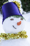 Snowman with a golden scarf. Smiling snowman with a golden scarf Stock Image