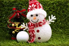Snowman with golf ball on X`mas time
