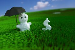 Snowman in the grass Royalty Free Stock Images