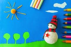Snowman on green grass. Figurative snowman on grass against blue sky Stock Photography