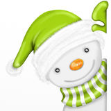 Snowman with green hat Royalty Free Stock Image