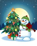 Snowman With Green Head Cover And Green Scarf Playing The Violin With Christmas Tree And Full Moon At Night Background For Your De Stock Photo