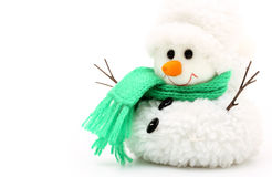 Snowman in green scarf Stock Photo