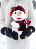 Snowman in hands on snow christmas decoration Royalty Free Stock Image