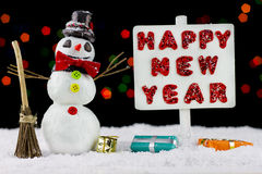Snowman with a Happy New Year signpost Royalty Free Stock Photography