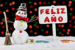 Snowman with a Happy New Year signpost Royalty Free Stock Photos